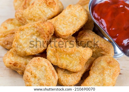 fastfood fresh hot chicken nuggets with ketchup