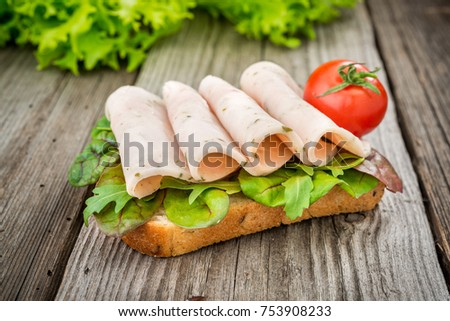 fastfood. sandwich with bacon and vegetables. ham