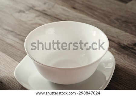 Fasting. empty plate and saucer on wooden background closeup. Top view. Copy space - stock photo