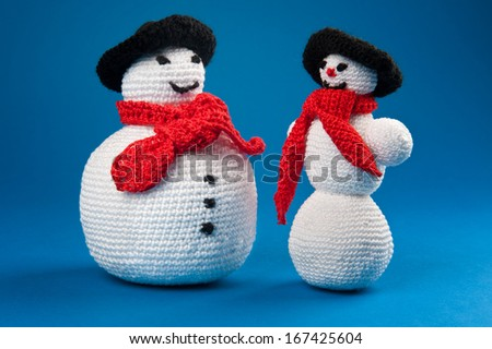 Fat and skinny crochet snowmen - stock photo