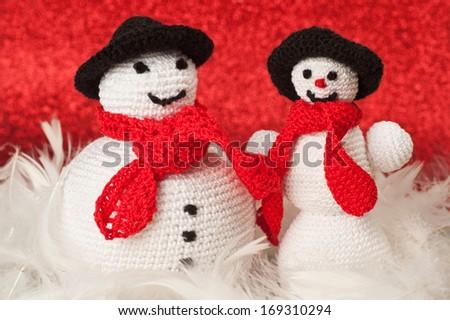 Fat and skinny crochet snowmen - stock photo