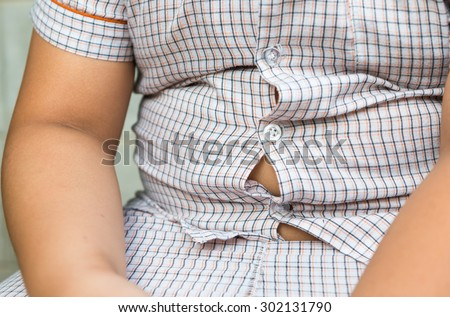 fat boy overweight. Tight shirt. - stock photo