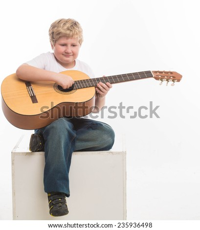 Fat Boy with Guitar Hobby Playing on White Background - stock photo