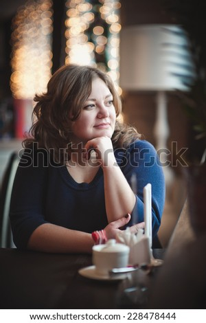 Fat girl in cafe - stock photo