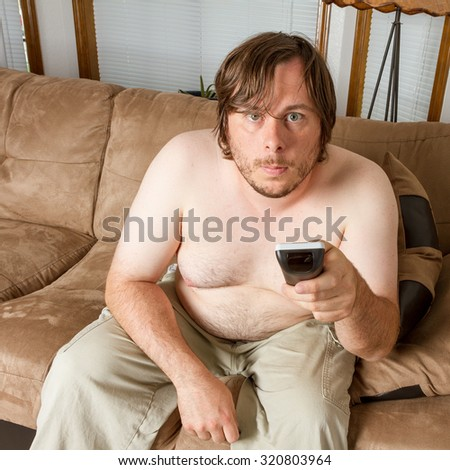 Fat guy using the remote at teh camera
