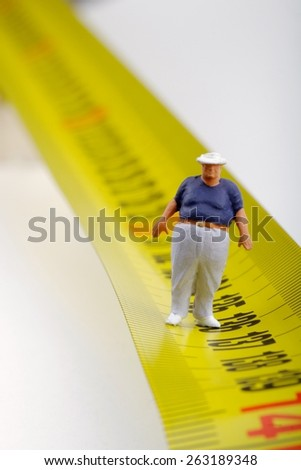 fat man and measurer - obesity concept - stock photo