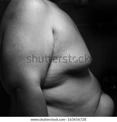 fat man black and white  - stock photo
