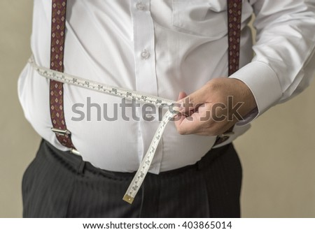 fat man check out his body fat with measuring tape fat fat fat obesity fat fat fat obesity fat fat fat obesity fat fat fat obesity fat fat fat obesity fat fat fat obesity fat fat fat obesity  - stock photo