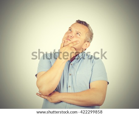 Fat man  chin on hand thinking daydreaming, staring thoughtfully upwards, - stock photo