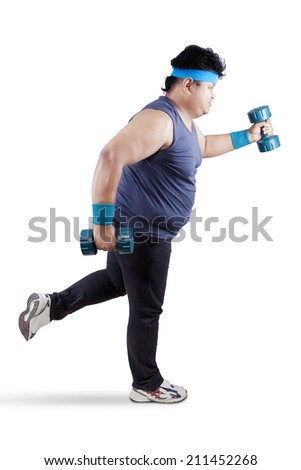 Fat man exercising with two dumbbells. Isolated on white background - stock photo