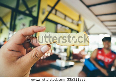 Fat man Hand holding toast in coffee shop