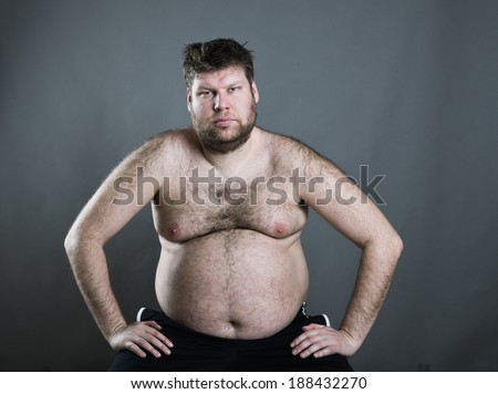 Fat man isolated on gray background - stock photo
