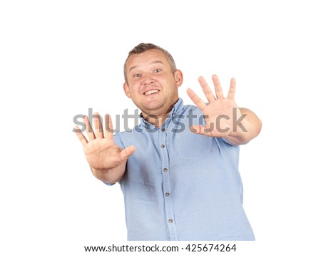 Fat man looking shocked scared trying to protect himself from unpleasant situation  Isolated on white background.. Negative emotion  - stock photo
