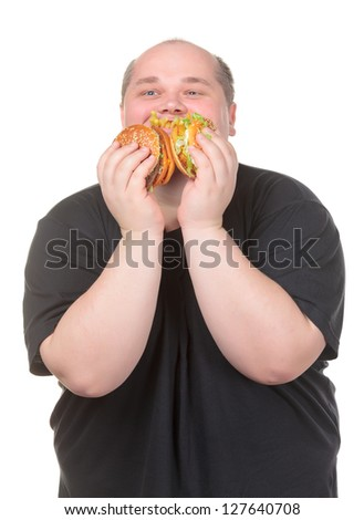 Fat Man Looks Lustfully at a Burger, on white background - stock photo