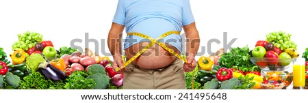 Fat man measuring her body. Diet and healthy nutrition. - stock photo