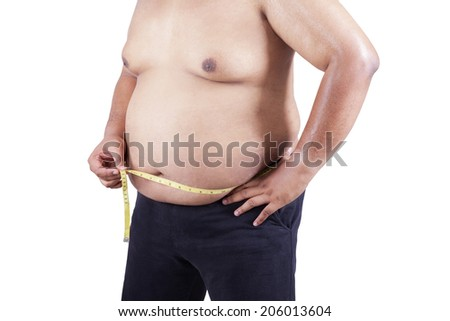 Fat man measuring his stomach. isolated on white background - stock photo