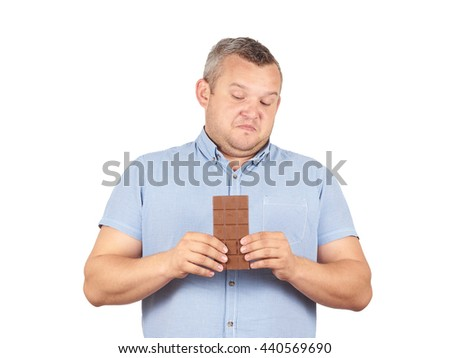 fat man refuses to chocolate. Diet, overweight, healthy food  Isolated on white background. - stock photo