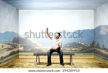 Fat man sitting on bench with book and reaching hand