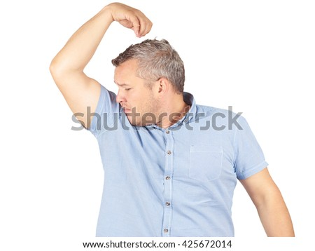 Fat man, smelling sniffing his armpit, something stinks bad, foul odor Isolated on white background.      - stock photo