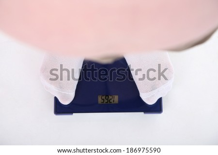 Fat man standing on electronic scales . Conceptual photo of weight loss. Isolated on white - stock photo