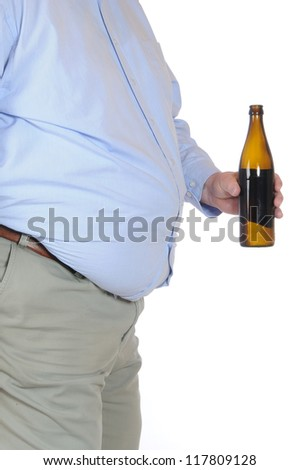 Fat man with a bottle of beer - stock photo