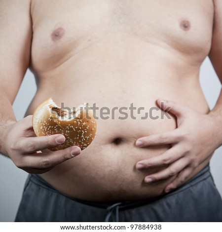 Fat man with hamburger isolated
