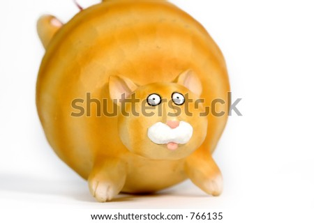 Fat orange cat ornament - stock photo