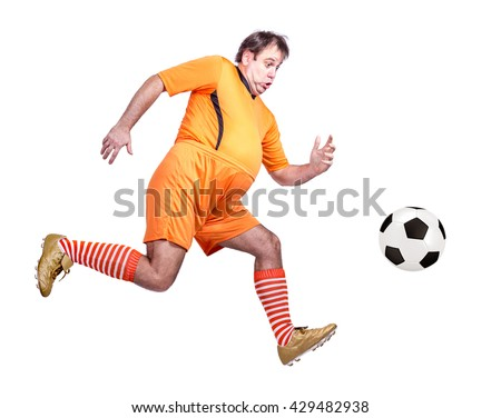 Fat soccer player kicking the ball isolated on a white background. Running football player kicking a ball. Thick soccer player running for the ball. Running recreational fat footballer with ball.