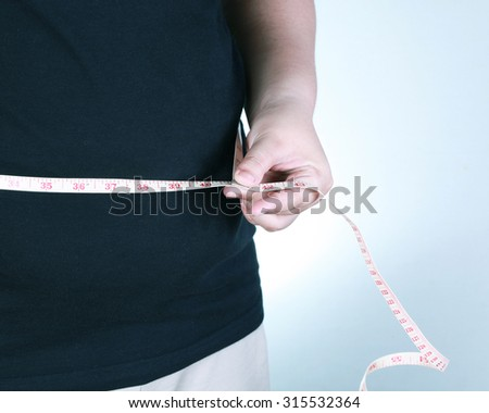 Fat woman body with measuring tape.Diet  concept. - stock photo