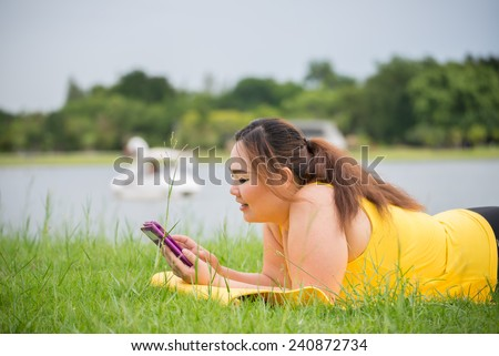 fat woman chatting in garden