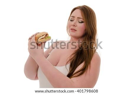 fat woman eating hamburger. Isolated. - stock photo