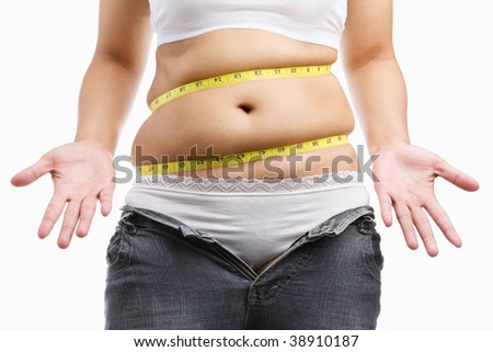 Fat woman give up wearing her tight jeans with measuring tape around her belly, a concept to start diet - stock photo