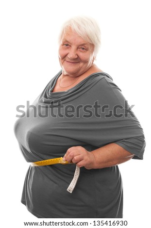 fat woman measuring waist. Isolated over white background - stock photo