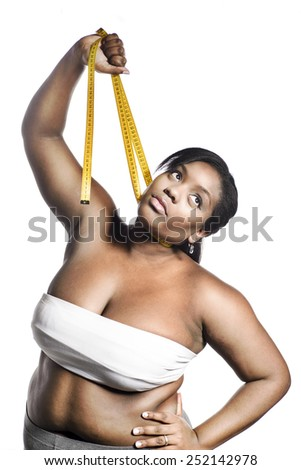 Fat woman with measuring tape - stock photo