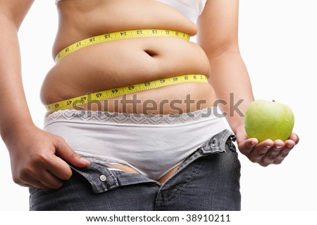 fat woman with unzip jeans holding apple, a concept to fight obesity by starting diet - stock photo