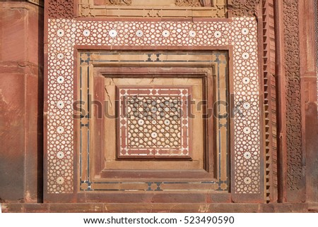 FATEHPUR SIKRI, INDIA - FEBRUARY 15 : Stone carvings on the wall in Fatehpur Sikri complex, Uttar Pradesh, India on February 15, 2016.