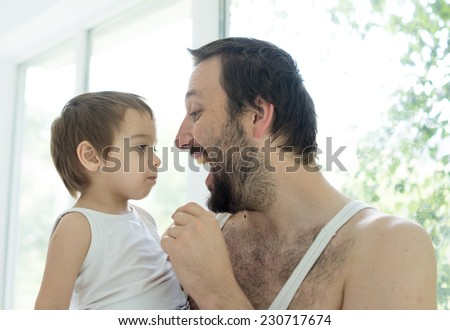Father and baby boy at home enjoying love - stock photo