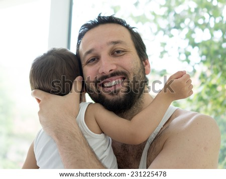 Father and baby boy at home enjoying love