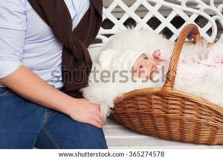 father and basket with newborn baby - stock photo
