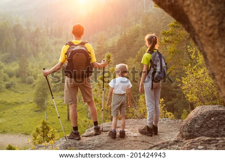 Father and children go hiking