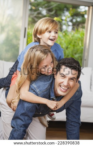 Father and children playing at home - stock photo