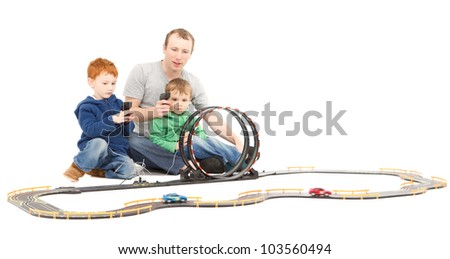 Father and children playing kids racing toy electric slot car game. On white.