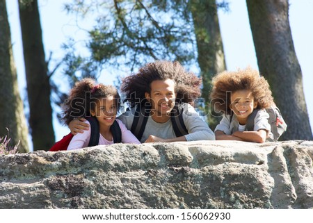 Father And Children Resting On Hike Through Countryside - stock photo