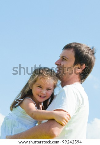 father and daughter against sky - stock photo