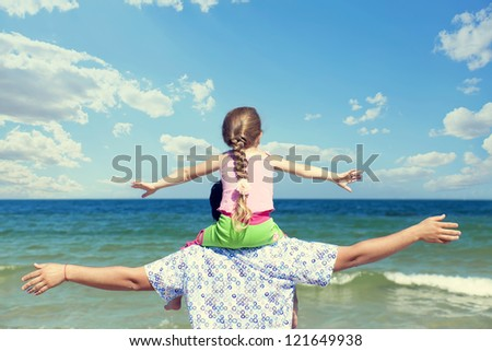 Father and daughter at outdoor. - stock photo