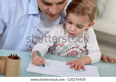 Father and daughter drawing - stock photo