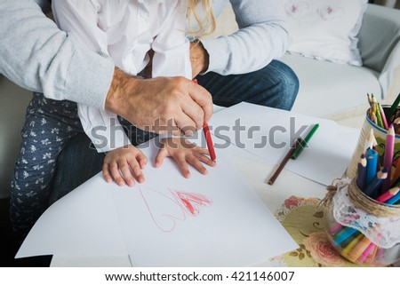 Father and daughter drawing together, creativity and learning concept