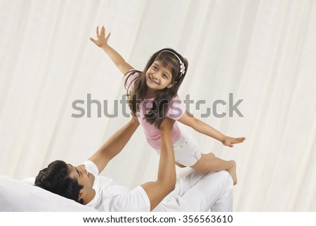 Father and daughter enjoying - stock photo