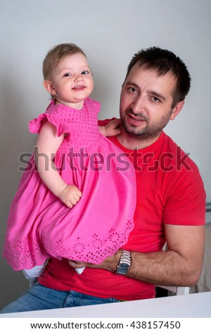 Father and daughter. Happy young father holding his smiling daughter - stock photo