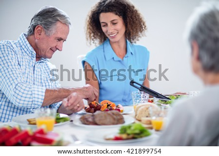 Father and daughter having breakfast together at home - stock photo